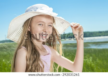 A Young beautiful girl at the beach.