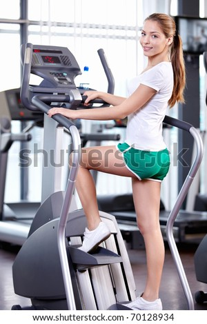 A young beautiful girl engaged in fitness - stock photo