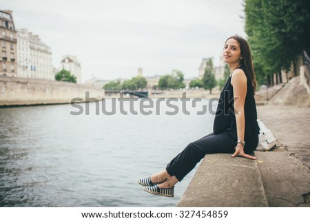 a young beautiful girl of Caucasian appearance in Paris