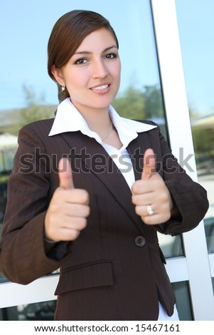 A young, beautiful hispanic business woman at office building - stock photo