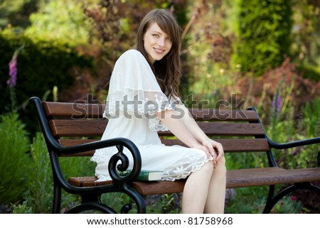 A young, beautiful lady enjoys the afternoon - stock photo