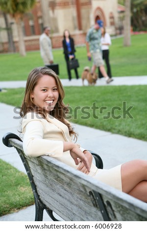 A young beautiful teacher on the school campus - stock photo