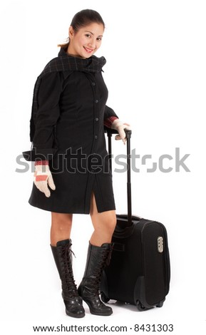 A young beautiful traveller holding her luggage