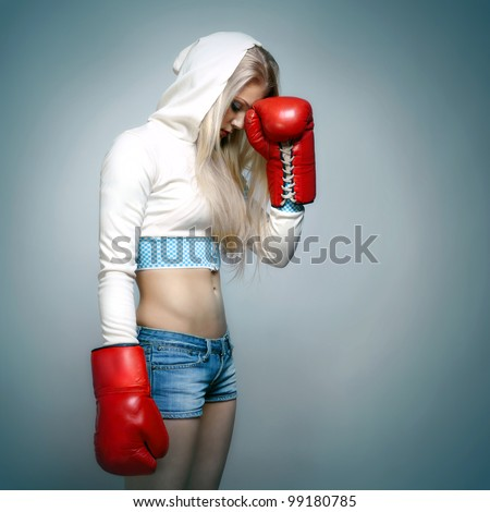 A young beautiful woman boxer - stock photo