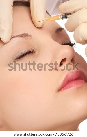A young beautiful woman having an injection - stock photo