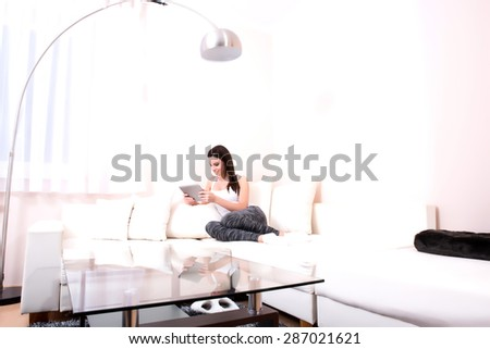 A young, beautiful woman in underwear lying on the sofa at home  - stock photo
