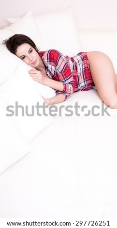 A young, beautiful woman in underwear lying on the sofa at home