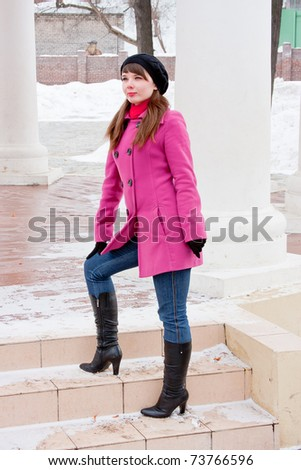a young beautiful  woman is in winter in a park