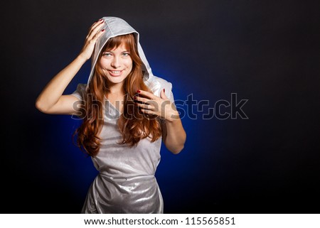 A young beautiful woman is smiling - stock photo