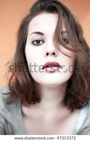 a young beautiful woman looking lascivious into the camera - stock photo