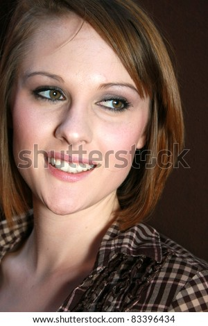 A young beautiful woman looking off to the side - stock photo