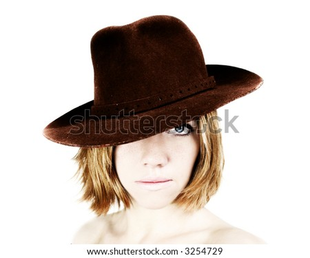 a young beautiful woman with blue eyes is wearing a cowboy hat