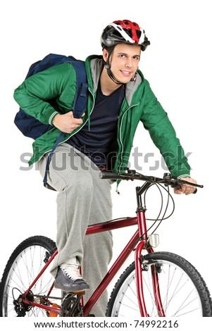 A young bicyclist on a bicycle posing isolated on white background - stock photo