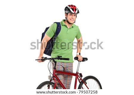A young bicyclist posing next to a bicycle isolated on white background - stock photo