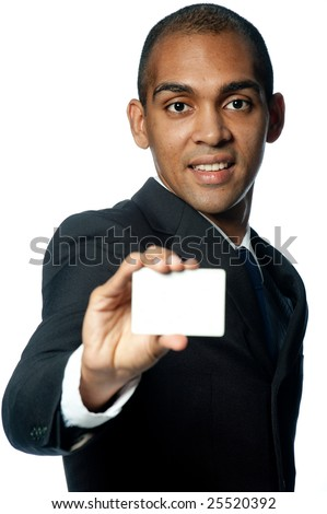 A young black businessman holding out a blank card on white background - stock photo