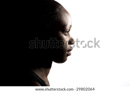A young black girl, shot in profile - stock photo