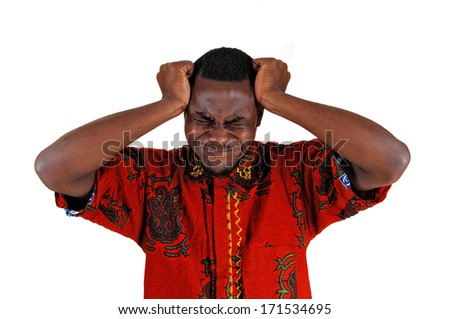 A young black man standing for white background with his hand on his head, looking very sad.  - stock photo