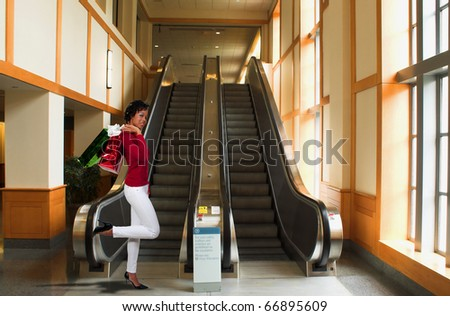 A young black woman on a shopping spree - stock photo