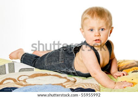 A young blond, blue-eyed boy playing - stock photo