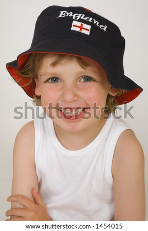 A young blond boy wearing an England hat