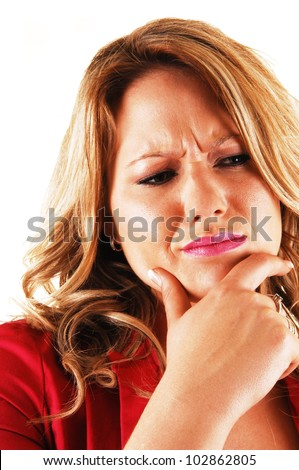 A young blond woman holding her chin with one hand and looking very serious about a problem in closeup over white. - stock photo