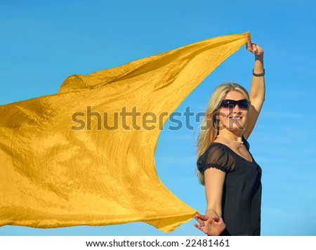 A young blond woman with a yellow scarf - stock photo