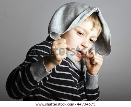 a young blonde street child fights for survival - stock photo