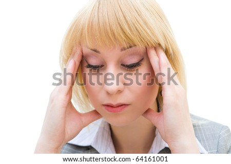 a young blonde woman suffers from headache - stock photo