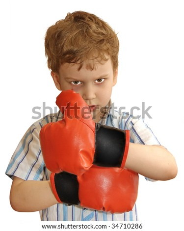 A young boxer with bruises in the boxing stand with unstoppable determination, isolated