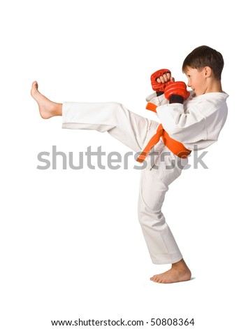 A young boy aikido fighter in white kimono isolated on white - stock photo