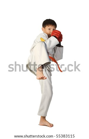 A young boy aikido fighter in white kimono isolated on white