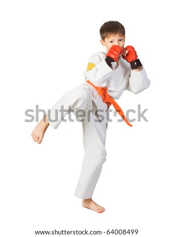 A young boy aikido fighter in white kimono showing Martial Art isolated on white - stock photo