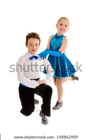 A Young Boy and Girl Tap Dance Partners in Recital Costume - stock photo