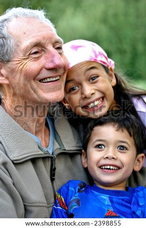 A young boy and his sister enjoying special times spent with their grandfather. Concept of love, togetherness, tenderness and family value. - stock photo