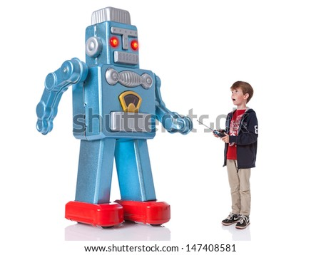 A young boy controlling a giant mechanical robot, isolated on a white background. - stock photo