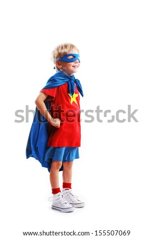 A young boy dreams of becoming a superhero, white background - stock photo