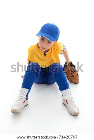 A young boy dressed in baseball tball sports clothing and wearing a leather glove mitt.  Sitting on white background. - stock photo