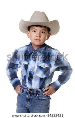 A young boy dressed in cowboy clothes. - stock photo