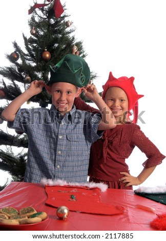 A young boy elf goofing off and trying to impress a young girl elf by showing her his elf ears