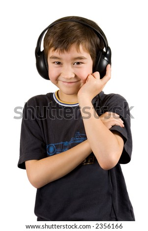 A young boy enjoying listening from his headphone. - stock photo