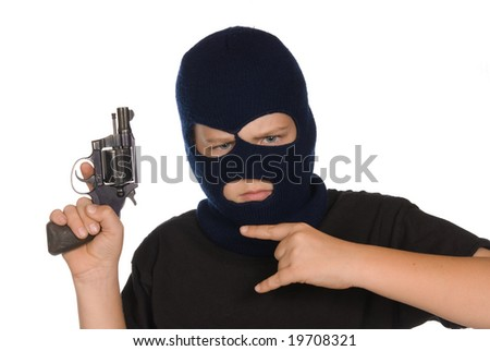 A young boy flashes his gang sign and weapon to show his commitment to crime and bad ways. - stock photo