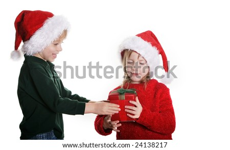 A young boy giving a girl a gift