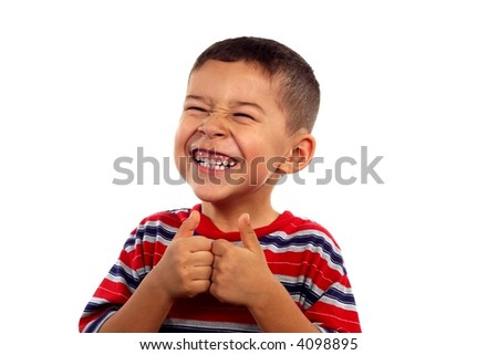 A young boy giving thumbs up and flashing a silly smile - stock photo