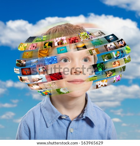 A young boy has different media images around his head. - stock photo