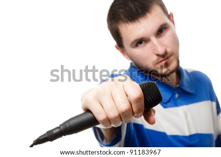A young boy holding a microphone, close up, isolated on a white background. - stock photo