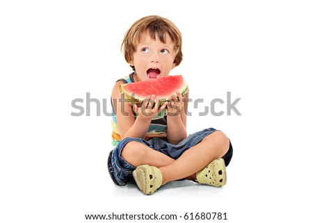 A young boy holding a slice of watermelon isolated against white background - stock photo