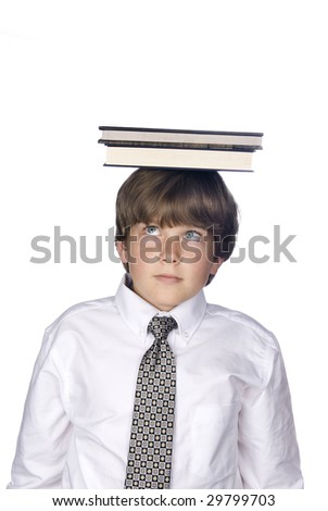 A young boy in a dress shirt and tie balances a book on top of his head. - stock photo
