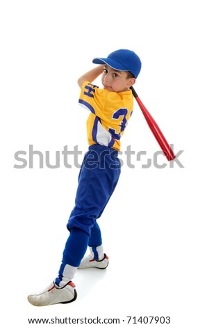 A young boy in a softball, baseball or t-ball uniform swings a bat.  White background. - stock photo