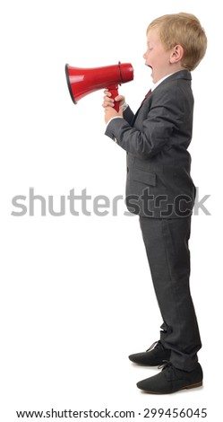 a young boy in suit shouting into a megaphone isolated on a white background - stock photo