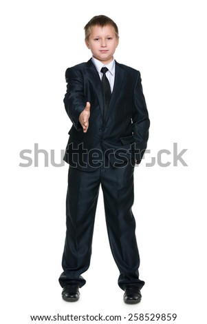 A young boy is going to shake a hand - stock photo